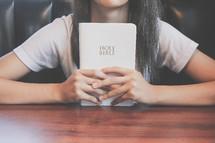 teen girl holding a Bible