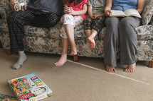 family sitting on the couch and board games on the floor