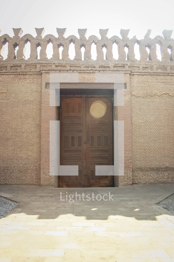 wooden door and rooftop details on a building in Egypt