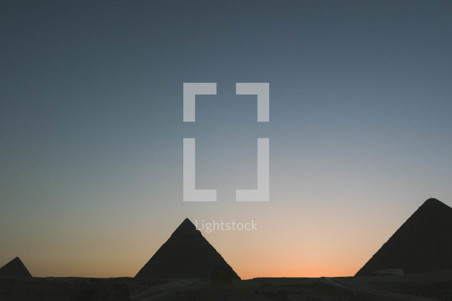 silhouettes of the pyramids in Egypt