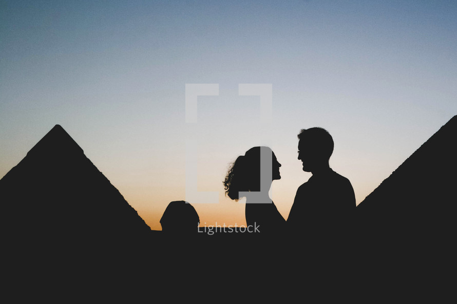 silhouette of a couple and the pyramids in Egypt
