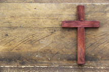 wooden cross on a wood background