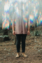 a man standing in blurry light
