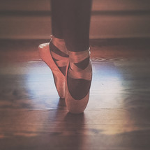 a ballerina in toe shoes