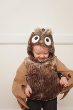 toddler boy in an owl Halloween costume