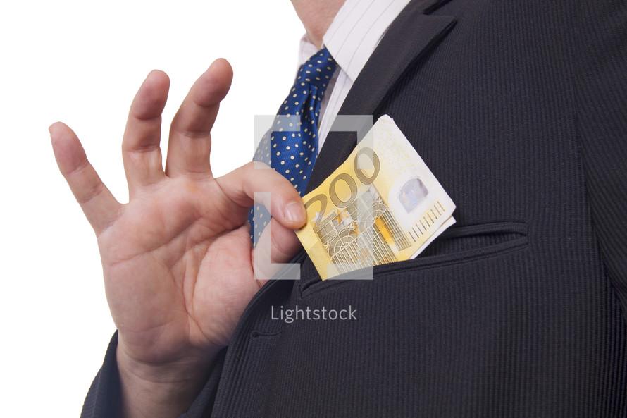 a man taking a bribe