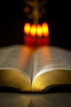 open Bible and candles