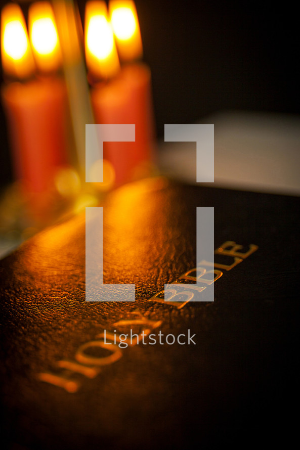 Bible cover and candles