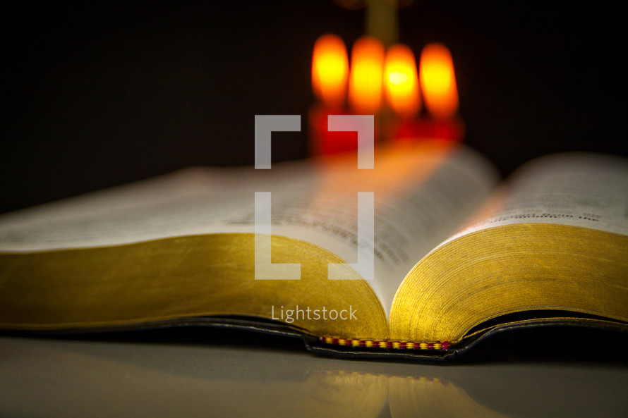 candles and open Bible