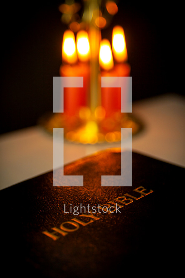 Bible and burning candles