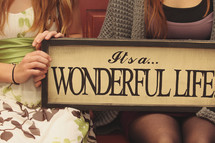 """it's a wonderful life"" quote on sign"