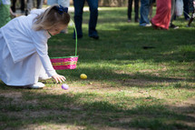 little girl with an Easter basket during and Easter egg hunt