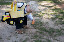 toddler boy with a dump truck Easter basket