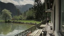 woman walking on a porch overlooking a lake
