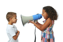 a sister yelling at her brother with a megaphone