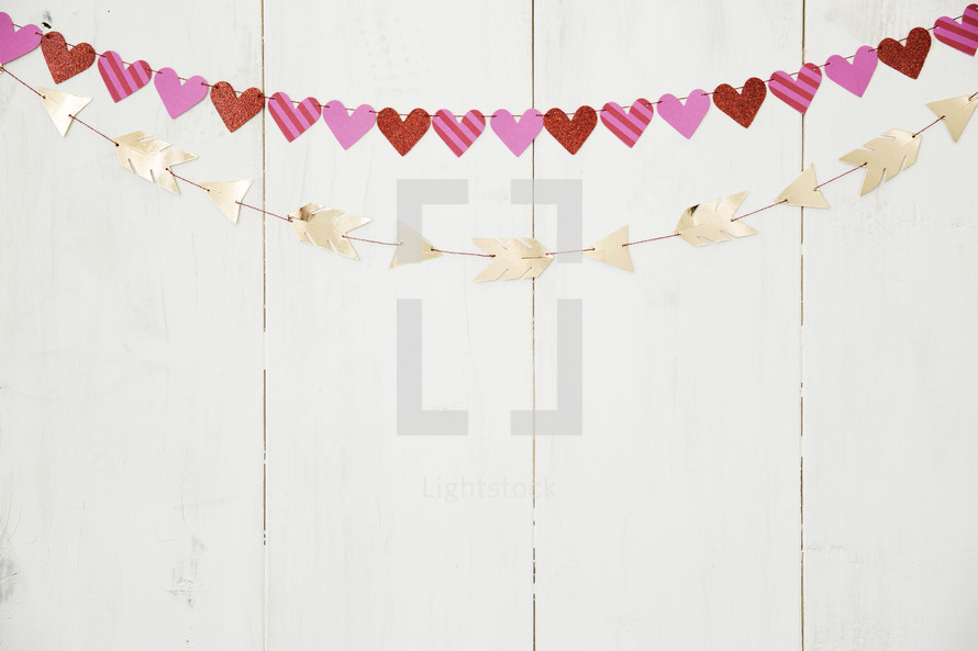 hearts and arrows banners on a white wall