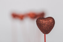 glittery heart on a stick