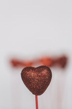blurry red heart on a stick