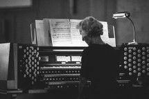 woman playing an organ