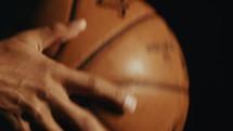 a man spinning a basketball