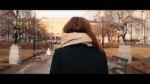 a woman walking in slow motion outdoors