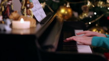 person playing a piano at Christmas