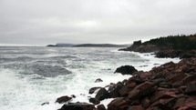 waves crashing into a rocky shore