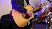 playing a guitar during a worship service