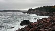 waves crashing into rocky shore