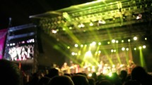 musicians on stage and stage lights at a concert