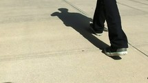 a man walking with a shadow