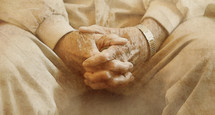 praying hands of an elderly man
