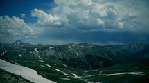 Timelapse of cloud movement over snow-covered mountains.
