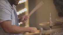 man playing drums on stage