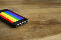 A rainbow colored background on a phone