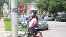 child riding a bike on a neighborhood street