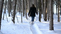 woman walking on a snowy path