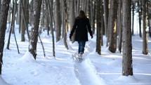 woman walking on a snowy path