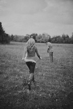 Couple walking through a field.