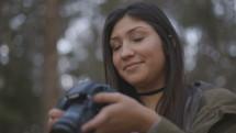 a woman looking at a camera screen