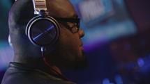 DJ with headphones.