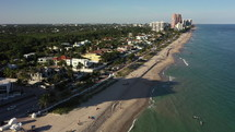 Exotic Aerial 4k View Up the Coastline of Fort Lauderdale Beach on a clear Sunny day in Florida