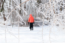 a woman standing outdoors in winter