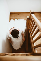 a bride walking down steps