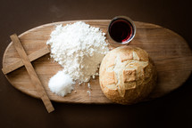 wine and bread and flour on a cutting board