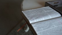 open Bible on a coffee table