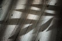shadow of leaves on wood