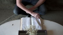 a man sitting down to read a Bible
