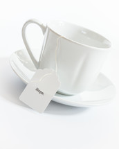 tea cup with tea bag with word hope