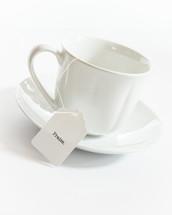 tea cup with the word praise on the tea bag